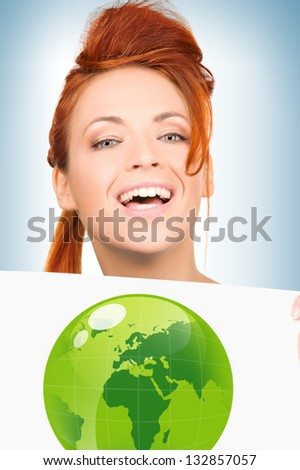 young woman with illustration of green eco globe - stock photo