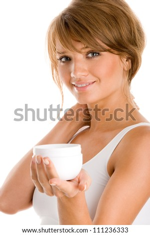 Young woman with jar of body lotion isolated on white background - stock photo