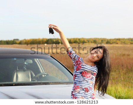 young woman with keys in hand, the car - stock photo