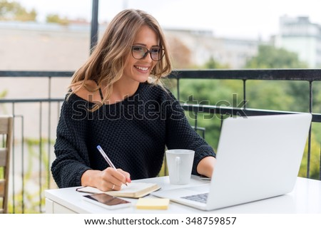 Young woman with laptop - stock photo