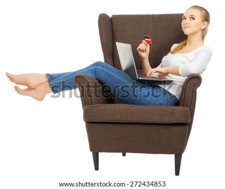 Young woman with laptop and credit card isolated - stock photo