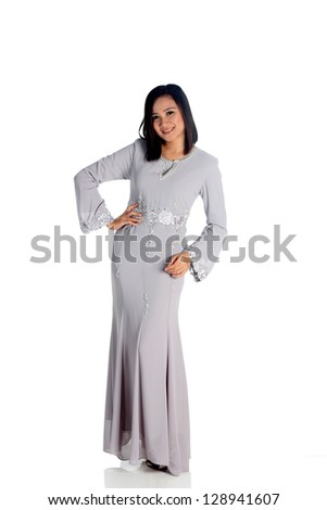 Young woman with long dress an isolated on white - stock photo