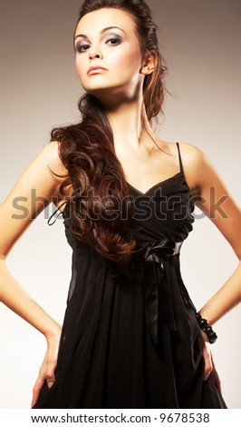 Young Woman with Long Hair Curling Around - stock photo