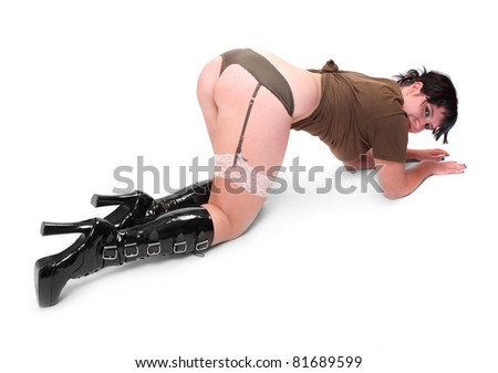 Young woman with long slim legs dressed in sexy lingerie and high boots. - stock photo