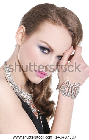 young woman with make-up. Jewelry and Beauty. - stock photo
