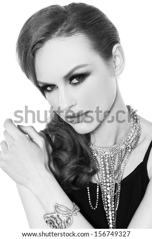 young woman with make-up. Jewelry and Beauty. in black and white - stock photo
