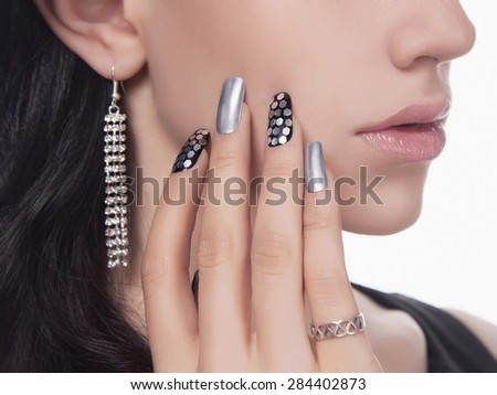 young woman with manicure.Beautiful model with make-up.Nail design - stock photo