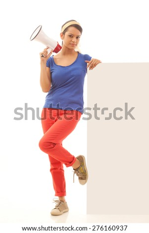 Young woman with megaphone leaning on white board - stock photo