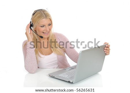 Young woman with microphone and computer having online conversation throw internet. help desk assistant - stock photo