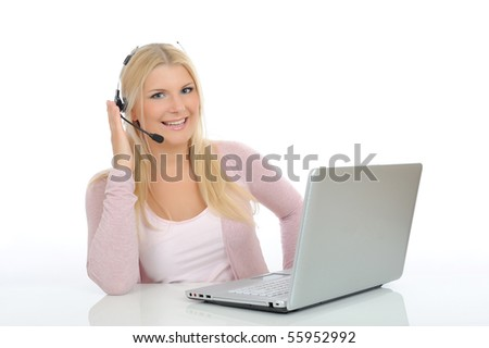 Young woman with microphone and laptop speaking. help desk assistant - stock photo