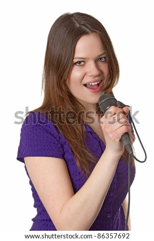 Young woman with microphone isolated on white background - stock photo
