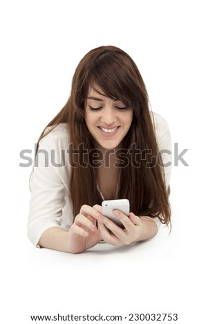 young woman with mobile phone against a white background - stock photo