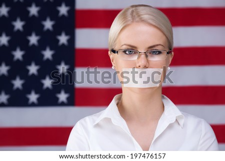 Young woman with mouth taped - stock photo