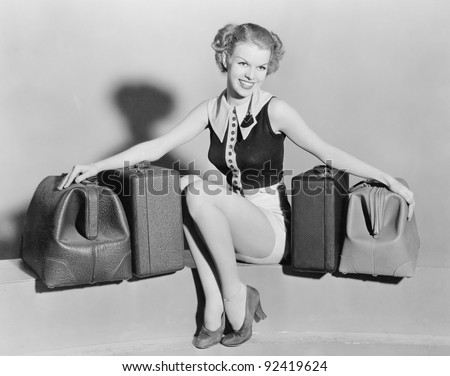 Young woman with old bags - stock photo