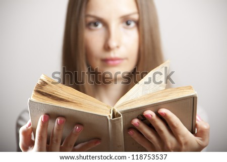 Young woman with old book - stock photo