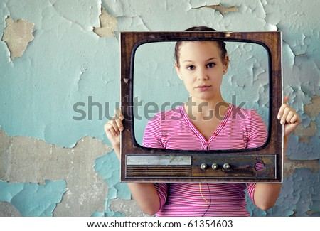young woman with old tv frame photo - stock photo