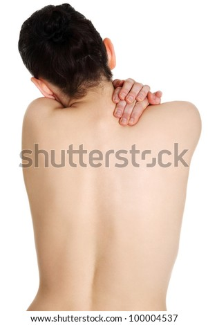 Young woman with pain in her back. Isolated - stock photo