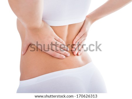 Young Woman With Pain In Her Back Over White Background - stock photo