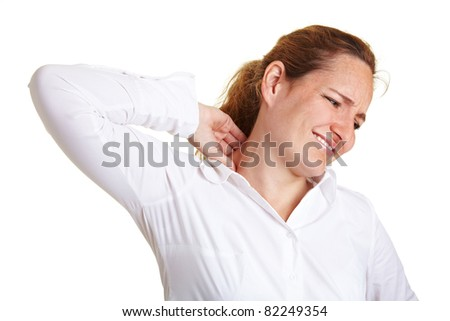 Young woman with pain massaging her neck - stock photo
