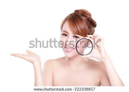 young woman with perfect skin and magnifying glass check it isolated on white background, concept for skin care - stock photo