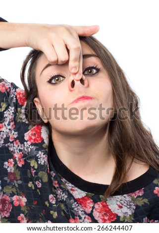 Young woman with pig funny face - stock photo