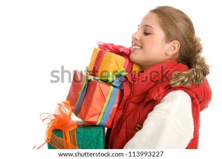 Young woman with pile of gifts - stock photo