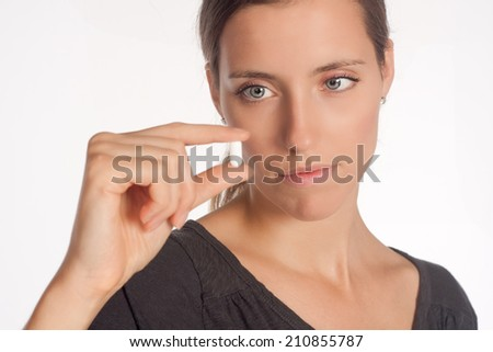 Young woman with pill in her hand - stock photo