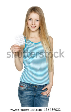Young woman with pills over white - stock photo