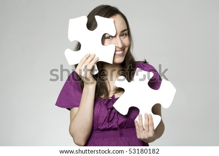young woman with puzzle parts - stock photo