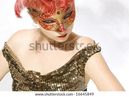young woman with red carnival mask on her face - stock photo