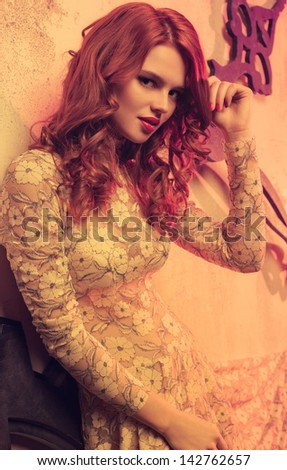 Young woman with red hair portrait. - stock photo