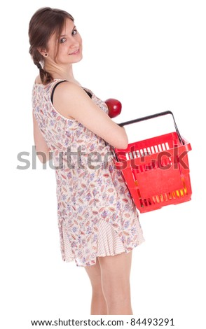 young woman with red shopping basket keeping apple - stock photo