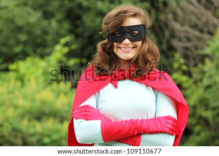 Young woman with red super heroes kit smiling - stock photo