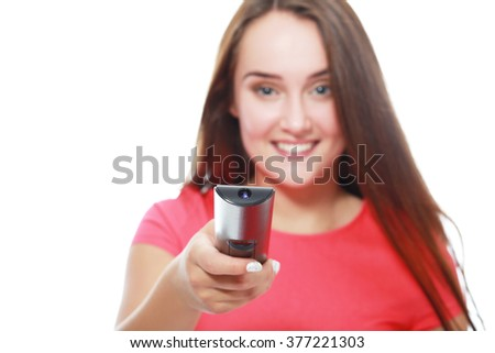 Young woman with remote control isolated close-up focused on remote control. - stock photo