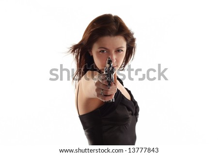 young woman with revolver isolated on white background - stock photo