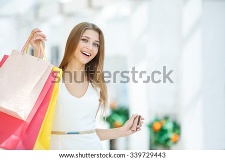 Young woman with shopping bags in the store - stock photo