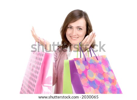 Young Woman With Shopping Bags Isolated on White - stock photo