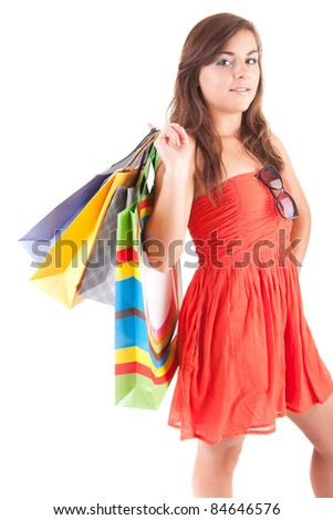 Young woman with shopping bags, isolated over white - stock photo