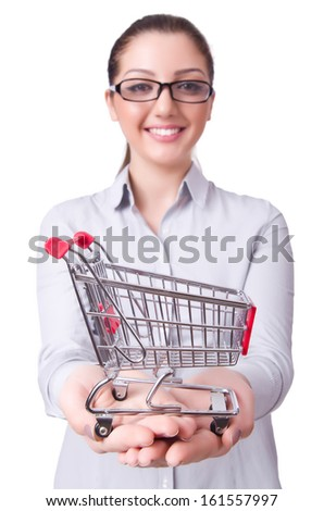 Young woman with shopping cart on white - stock photo