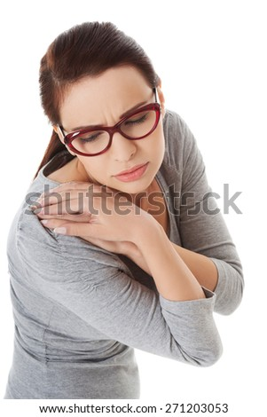 Young woman with shoulder pain. - stock photo