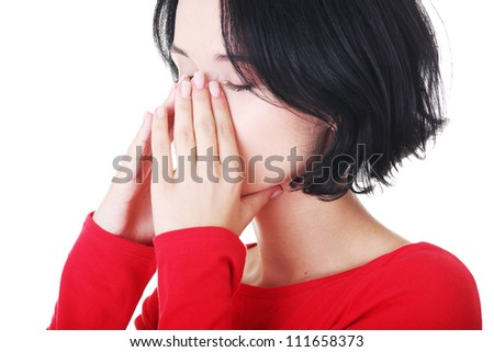 Young woman with sinus pressure pain , isolated on white - stock photo