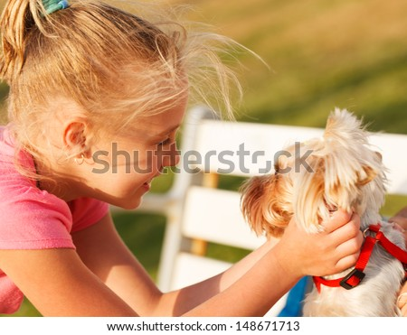 Young woman with small dog - stock photo
