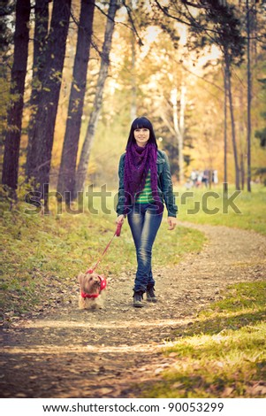 Young woman with small terrier dog - stock photo