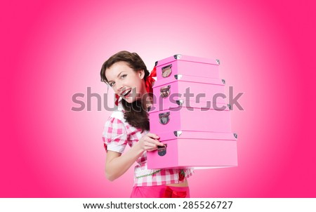 Young woman with storage boxes on white - stock photo