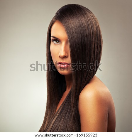 Young woman with straight hair - stock photo
