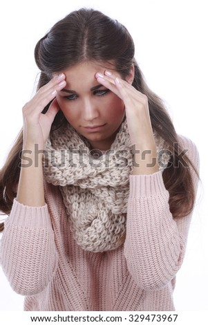 Young woman with strong headache touching her forehead with her hands - stock photo