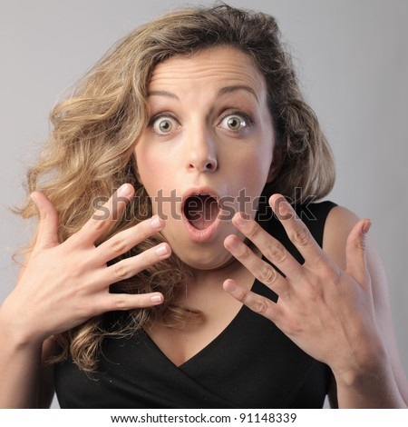 Young woman with surprised expression - stock photo