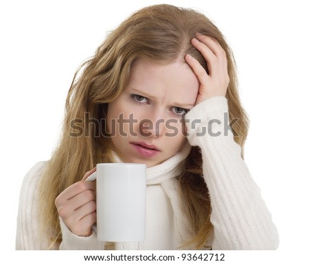 young woman with the flu and headache with a mug of hot tea isolated on white background - stock photo