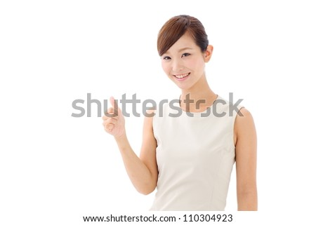 Young woman with thumbs up gesture, isolated on white background - stock photo