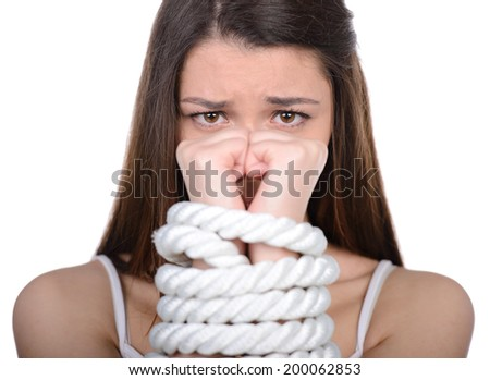 Young woman with tied up hands over white background - stock photo
